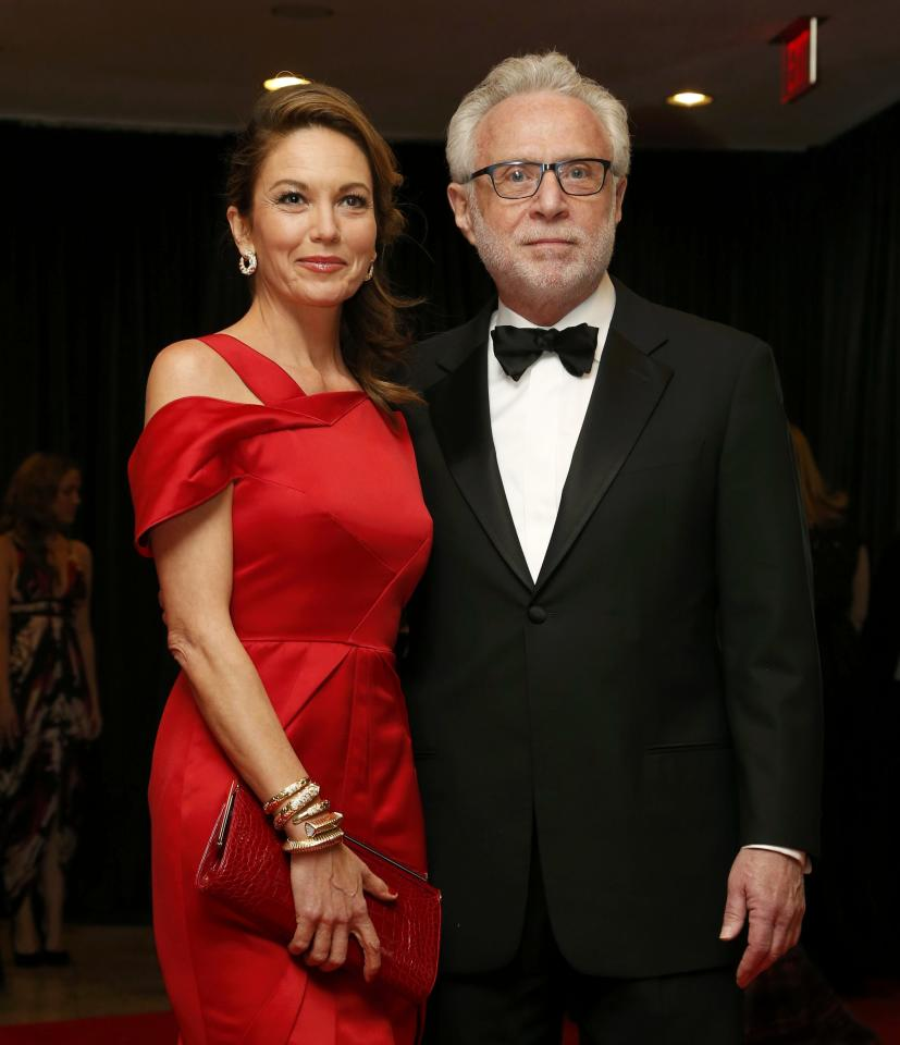 Actress Diane Lane and journalist Wolf Blitzer arrive on the red carpet at the annual White House Correspondents' Association Dinner in Washington, May 3, 2014. REUTERS/Jonathan Ernst (UNITED STATES - Tags: POLITICS MEDIA ENTERTAINMENT SOCIETY)