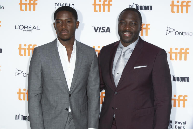 Damson Idris and Adewale Akinnuoye-Agbaje attend the premiere of 'Farming' at the 2018 Toronto International Film Festival. (Photo by Geoff Robins/AFP/Getty Images)
