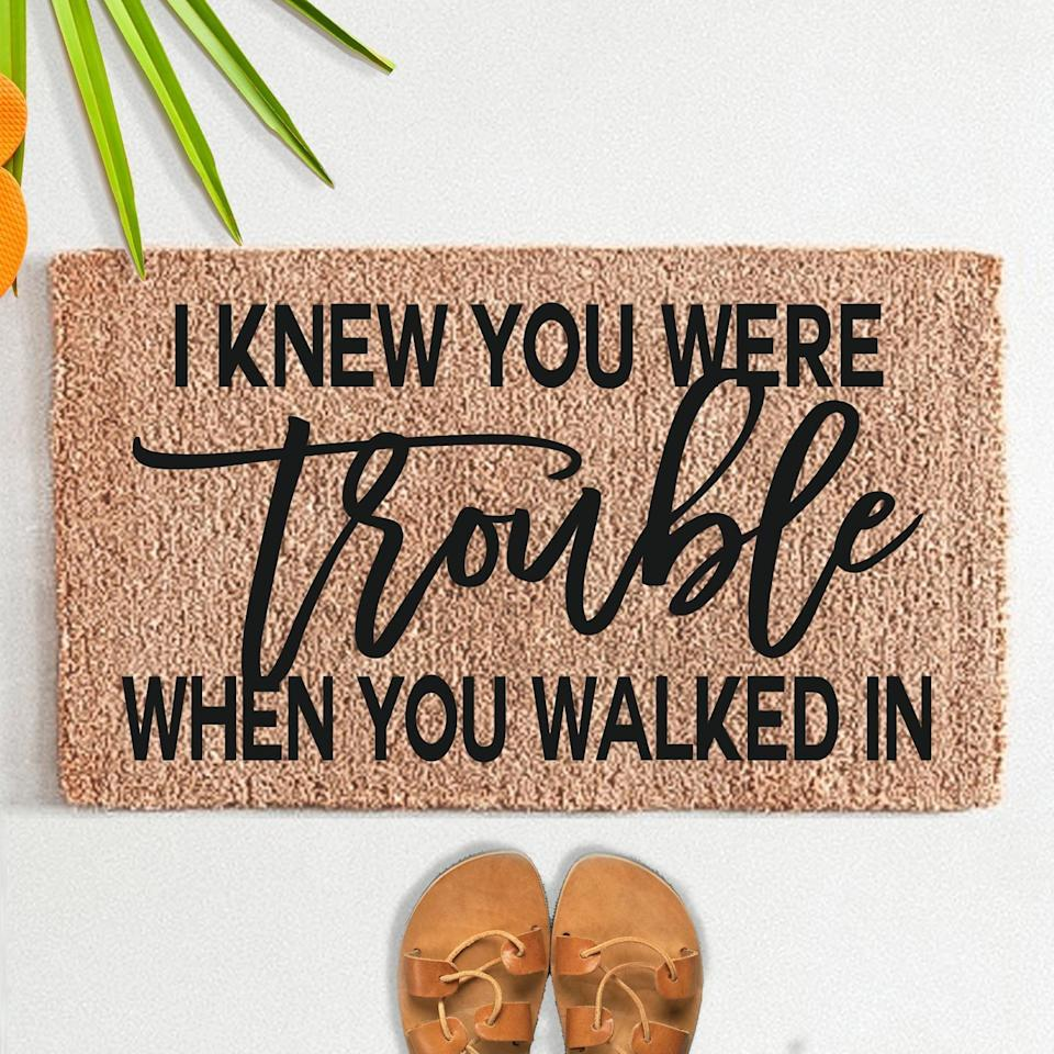 <p>There's nothing better than this <span>I Knew You Were Trouble When You Walked In Doormat</span> ($50, originally $55).</p>
