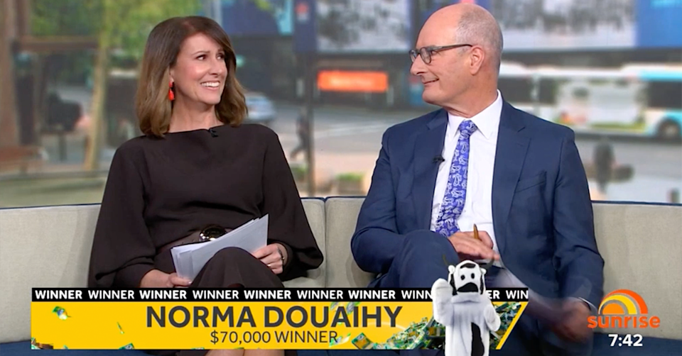 Sunrise hosts Nat Barr and Kochie looking at each other.