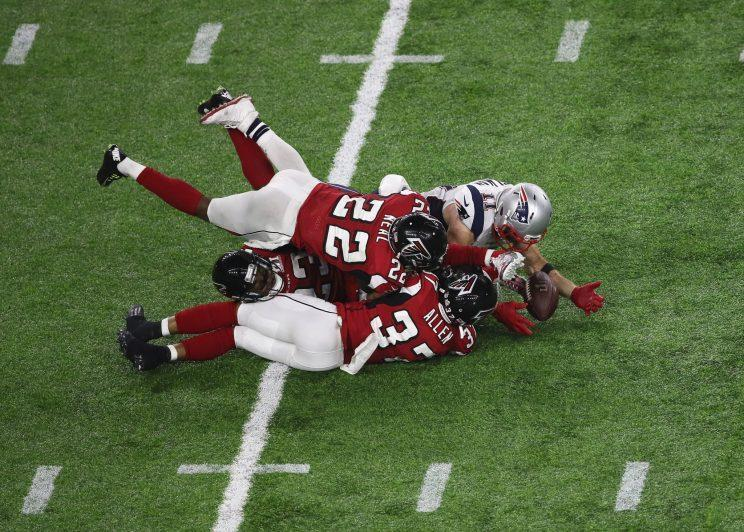 Julian Edelman somehow got his hands under the ball to make a catch that saved the Super Bowl for the Patriots. (Getty Images)