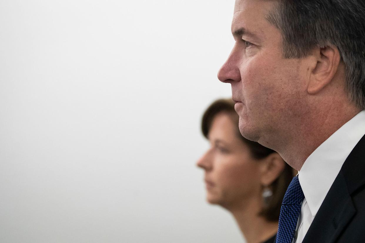 Ashley Kavanaugh holds hands with her husband, Supreme Court nominee Judge Brett Kavanaugh, as they arrive for his testimony before the Senate Judiciary Committee on Capitol Hill.