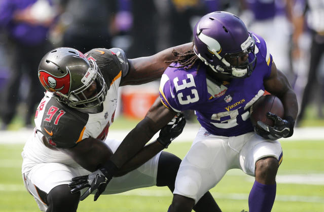 FILE - In this Sept. 24, 2017, file photo, Minnesota Vikings running back Dalvin Cook (33) tries to break a tackle by Tampa Bay Buccaneers defensive end Robert Ayers (91) during the first half of an NFL football game in Minneapolis. The Detroit Lions have signed free agent Ayers. He is entering his 10th NFL season. (AP Photo/Jim Mone, File)