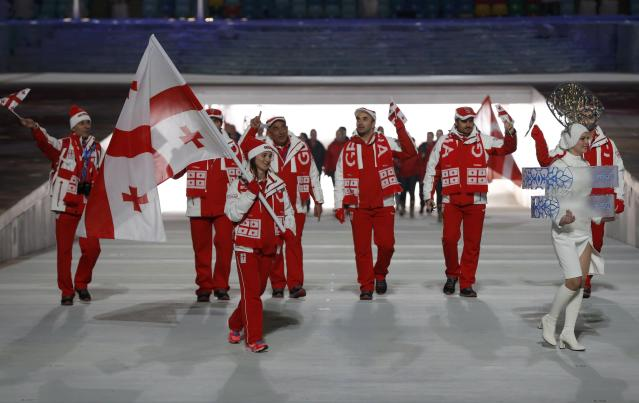 Georgia's flag-bearer Nino Tsiklauri leads his country's contingent during the opening ceremony of the 2014 Sochi Winter Olympics, February 7, 2014. REUTERS/Phil Noble (RUSSIA - Tags: OLYMPICS SPORT)