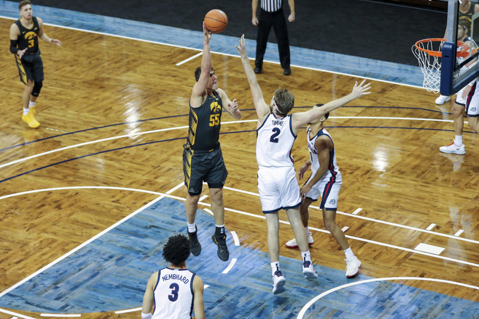 Iowa center Luka Garza (55) shoots a hook shot over Gonzaga defender Drew Timme (2) during the first half of an NCAA college basketball game Saturday, Dec. 19, 2020, in SIoux Falls, S.D. (AP Photo/Josh Jurgens)