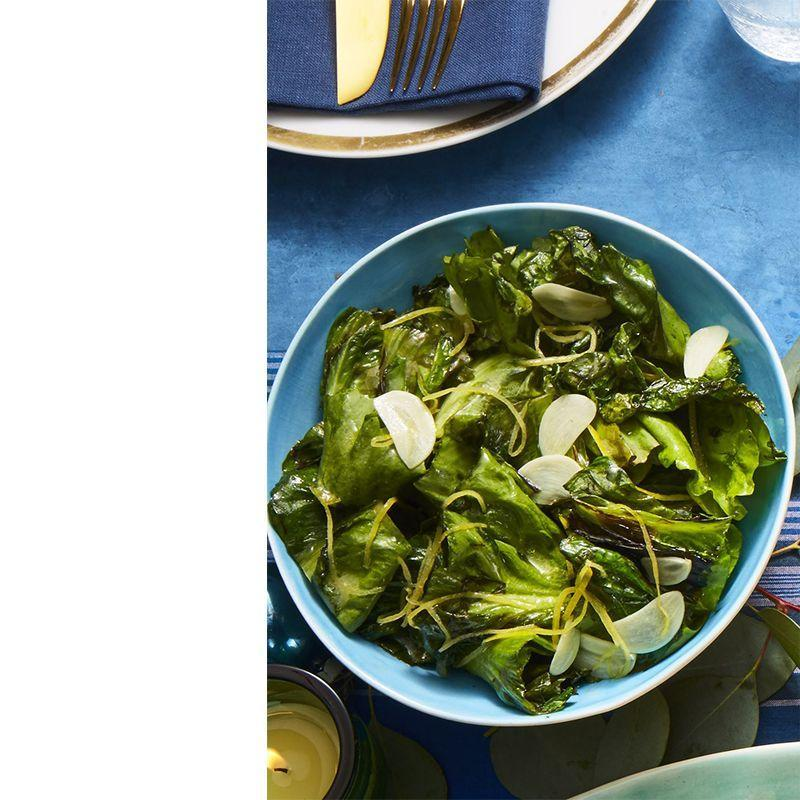 """<p>Take advantage of escarole being in season these next months by preparing this delicious salad.</p><p><a href=""""https://www.womansday.com/food-recipes/food-drinks/a25362011/quick-charred-escarole-with-sauteed-garlic-and-lemon-recipe/"""" rel=""""nofollow noopener"""" target=""""_blank"""" data-ylk=""""slk:Get the Charred Escarole with Sauteed Garlic and Lemon recipe."""" class=""""link rapid-noclick-resp""""><em>Get the Charred Escarole with Sauteed Garlic and Lemon recipe.</em></a></p>"""