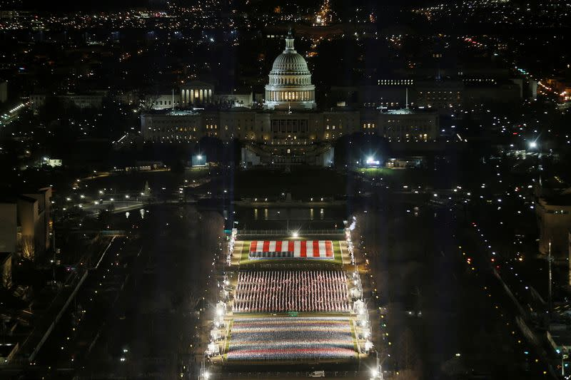 """The """"Field of Flags"""" is illuminated on the National Mall, in Washington"""