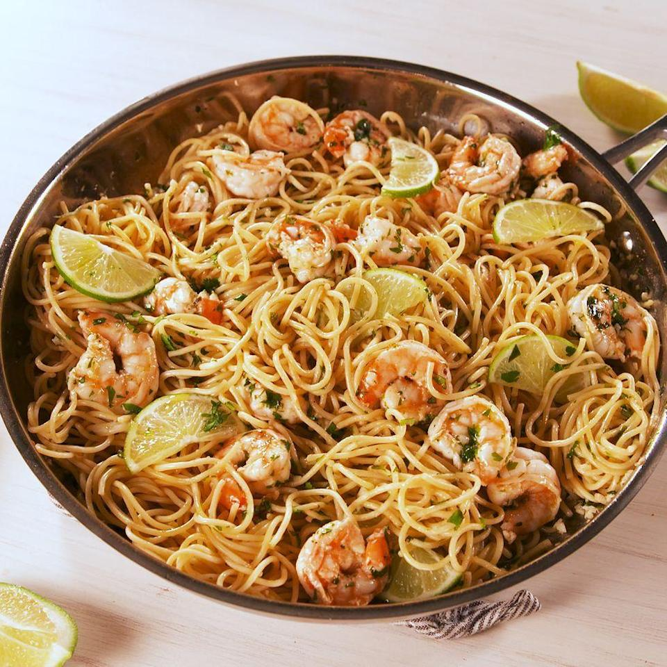 """<p>The garlicky butter sauce is out-of-this-world. </p><p>Get the <a href=""""https://www.delish.com/uk/cooking/recipes/a32608883/cilantro-lime-shrimp-pasta-recipe/"""" rel=""""nofollow noopener"""" target=""""_blank"""" data-ylk=""""slk:Coriander-Lime Prawn Pasta"""" class=""""link rapid-noclick-resp"""">Coriander-Lime Prawn Pasta</a> recipe.</p>"""