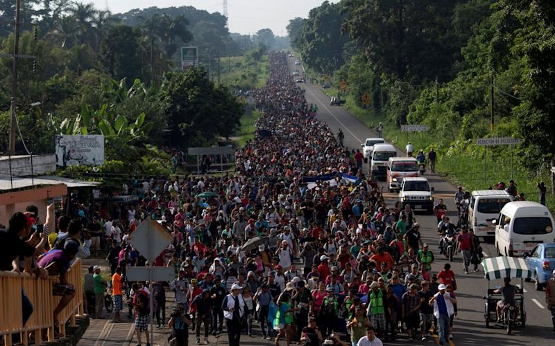 A migrant caravan passes through Guatemala in October 2018. Another is en route through Mexico, and yet another large one believed to be forming in Honduras - REUTERS