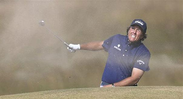 """<b class=""""credit"""">Scott Heppell/AP</b>Phil Mickelson of the United States plays out of a bunker on the 15th hole during the third round of the British Open Golf Championship at Muirfield, Scotland, on July 20."""