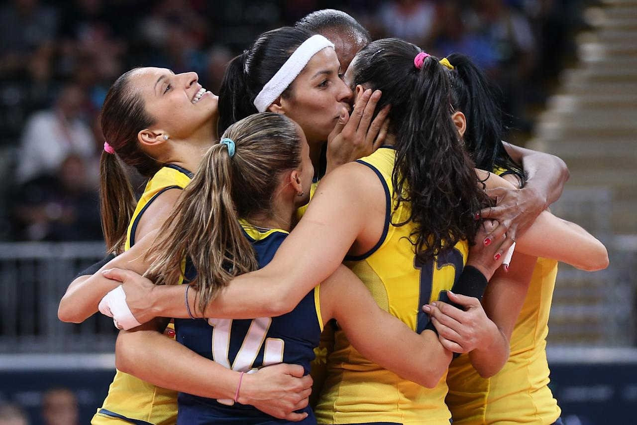 Brazil player celebrate winning a point in the Women's Volleyball Preliminary match between the United States and Brazil on Day 3 of the London 2012 Olympic Games at Earls Court on July 30, 2012 in London, England.  (Photo by Elsa/Getty Images)