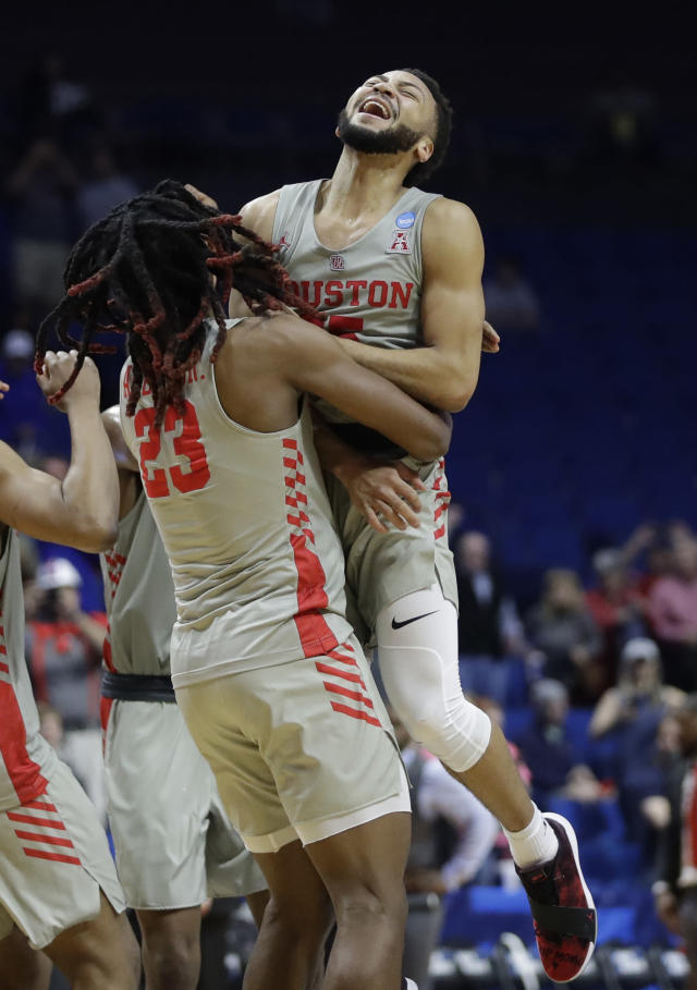 Houston's Galen Robinson Jr. celebrates with teammate Cedrick Alley Jr. (23) after defeating Ohio State in a second round men's college basketball game in the NCAA Tournament Sunday, March 24, 2019, in Tulsa, Okla. Houston won 74-59. (AP Photo/Jeff Roberson)