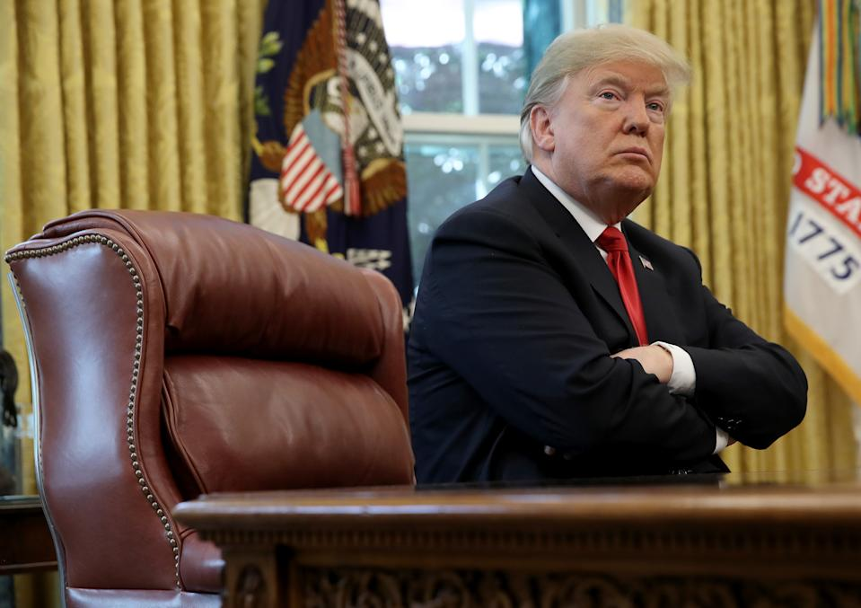WASHINGTON, DC - OCTOBER 10: U.S. President Donald Trump (L) discusses the potential impact of Hurricane Michael during a meeting with Homeland Security Secretary Kirstjen Nielsen and FEMA Administrator Brock Long in the Oval Office of the White House on October 10, 2018 in Washington, DC. Hurricane Michael has recently been upgraded to a category 4 storm. (Photo by Win McNamee/Getty Images)