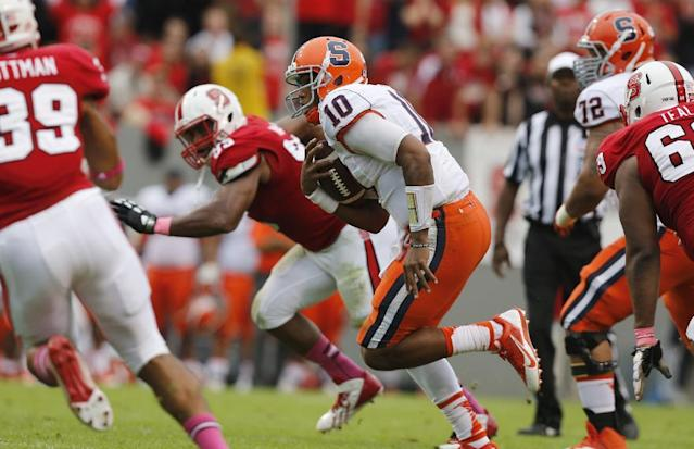 Syracuse quarterback Terrel Hunt (10) scrambles for a first down during the first half against North Carolina State in an NCAA college football game Saturday, Oct. 12, 2013, at Carter-Finley Stadium in Raleigh, N.C. (AP Photo/The News & Observer, Ethan Hyman)