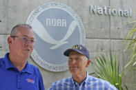 National Hurricane Center director Ken Graham, left, speaks during a news conference along with Sen. Rick Scott, R-Fla.,Tuesday, June 1, 2021, at the center in Miami. Tuesday marks the start of the 2021 Atlantic hurricane season which runs to Nov. 30. (AP Photo/Wilfredo Lee)