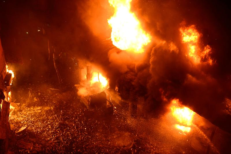 Firefighters try to douse a fire in Dhaka, Bangladesh on Feb. 20, 2019. A devastating fire raced through at least five buildings in an old part of Bangladesh's capital and killed scores of people. (Photo: AP)