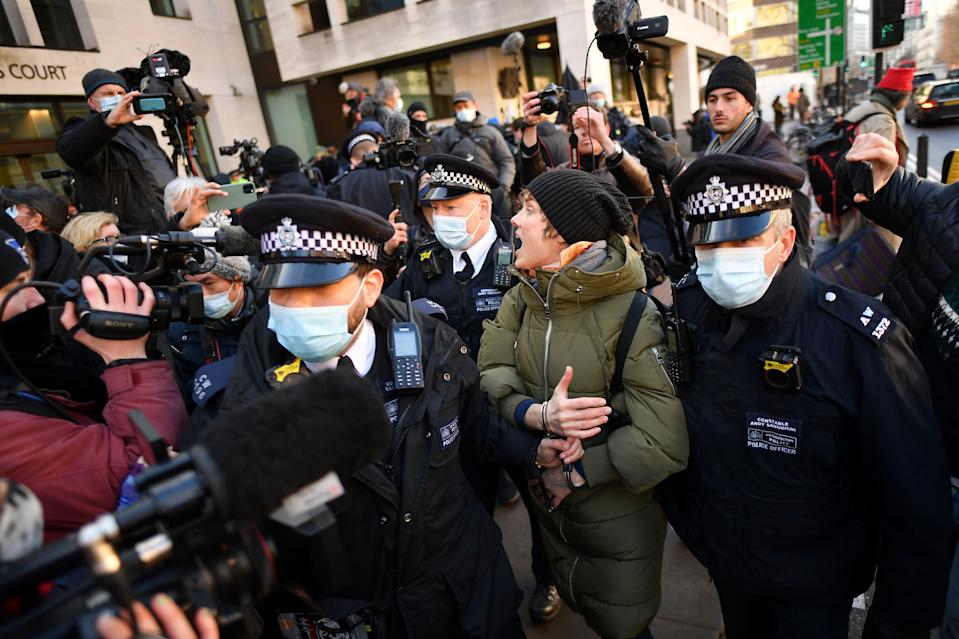 Police arrest a supporter of Wikileaks founder Julian Assange outside Westminster Magistrates court in London as he appears for a bail hearing on January 6, 2021. (Photo by JUSTIN TALLIS / AFP) (Photo by JUSTIN TALLIS/AFP via Getty Images)