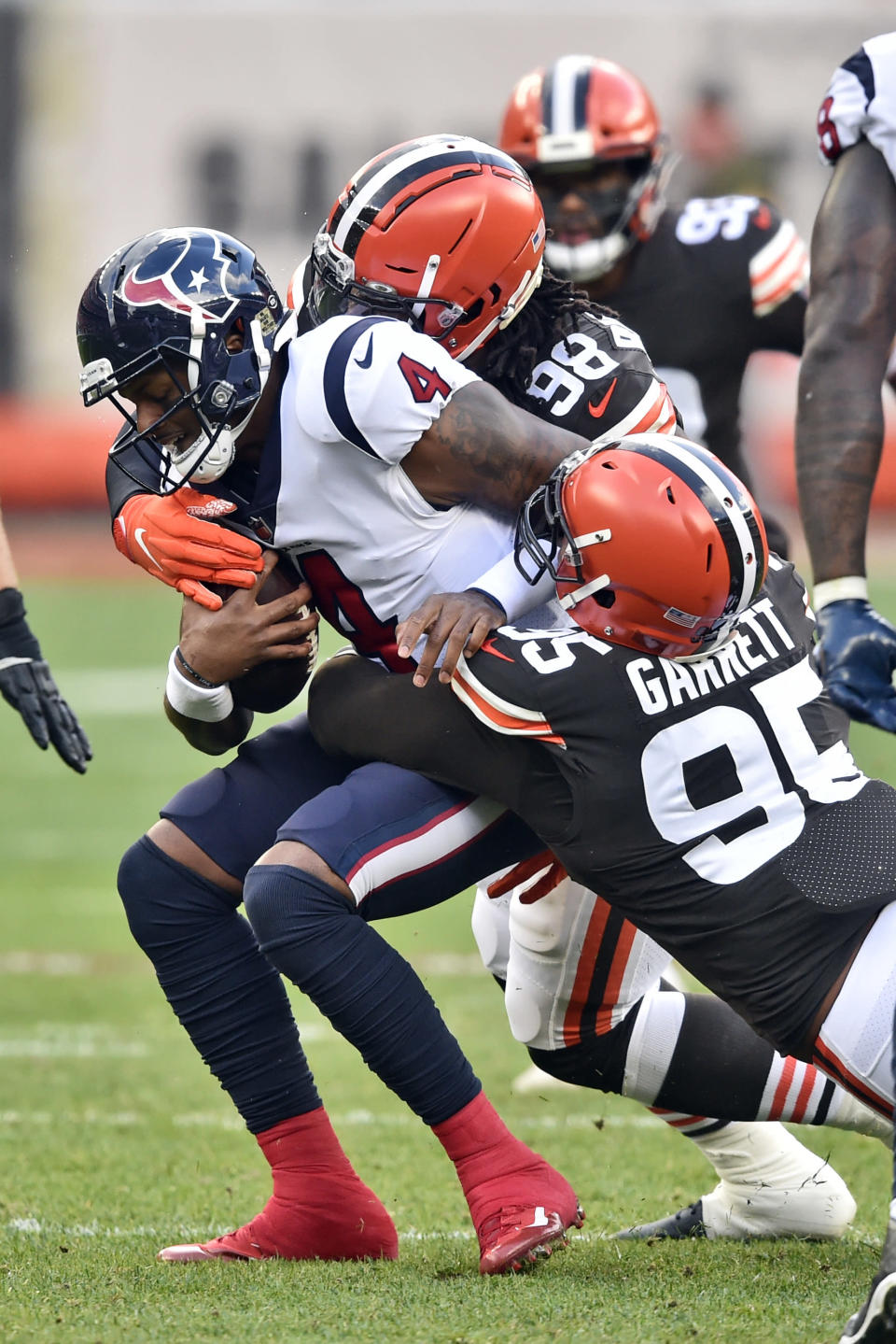 Cleveland Browns defensive end Myles Garrett (95) sacks Houston Texans quarterback Deshaun Watson (4) during the first half of an NFL football game, Sunday, Nov. 15, 2020, in Cleveland. (AP Photo/David Richard)