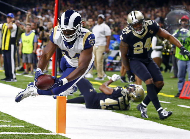 Los Angeles Rams running back Malcolm Brown (34) scores a touchdown in front of New Orleans Saints free safety Marcus Williams (43) and strong safety Vonn Bell (24) in the second half of an NFL football game in New Orleans, Sunday, Nov. 4, 2018. (AP Photo/Butch Dill)
