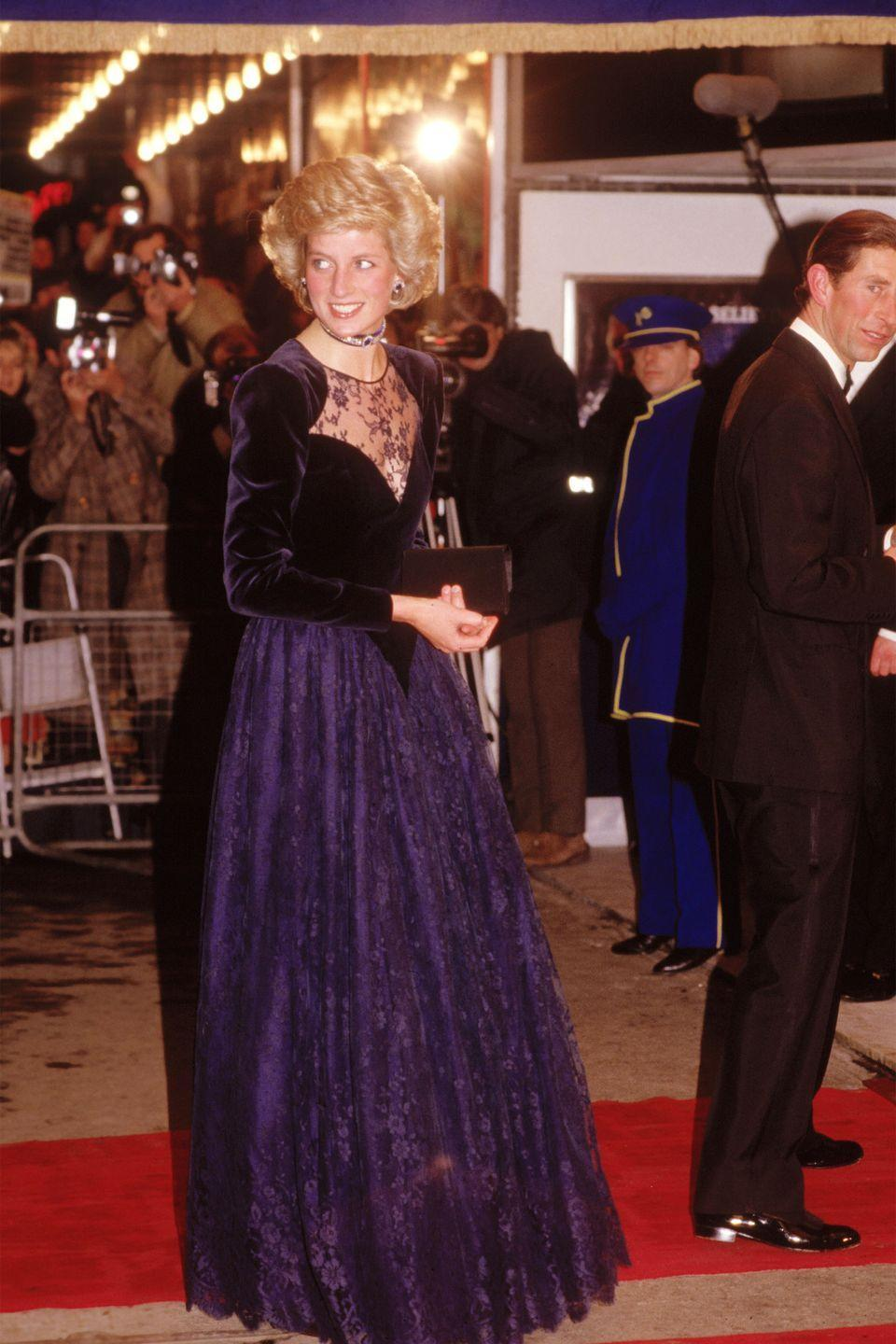 <p>In a purple Catherine Walker dress with velvet detailing while attending the premiere of The Santa Claus in London. </p>