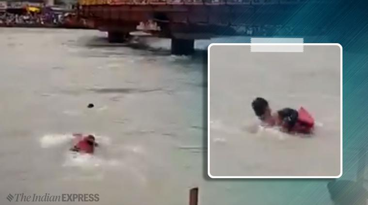 ganga, uttarakhand police, cop hailed as hero, cop ganga viral video, cop rescues drowning man, UK police, trending,