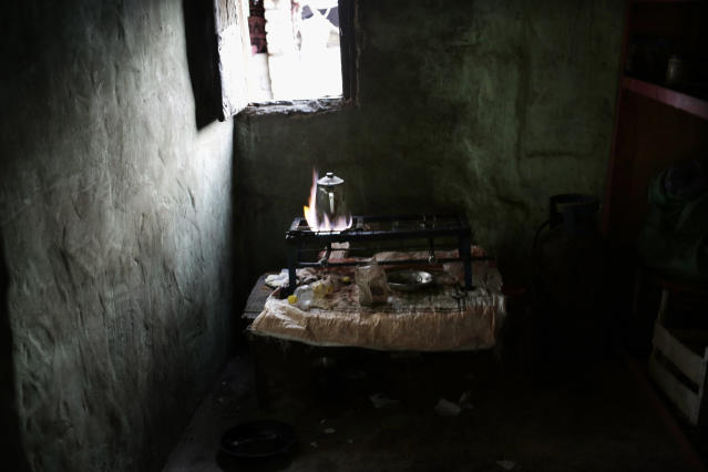 In this March 30, 2019 photo, shows the kitchen in Umm Yasser's home in Wadi Sahw, Abu Zenima, in South Sinai, Egypt. Umm Yasser is breaking new ground among the deeply conservative Bedouin of Egypt's Sinai Peninsula. Women among the Bedouin almost never work outside the home, and even more rarely do they interact with outsiders. But Umm Yasser is one of four women from the community who for the first time are working as tour guides. (AP Photo/Nariman El-Mofty)