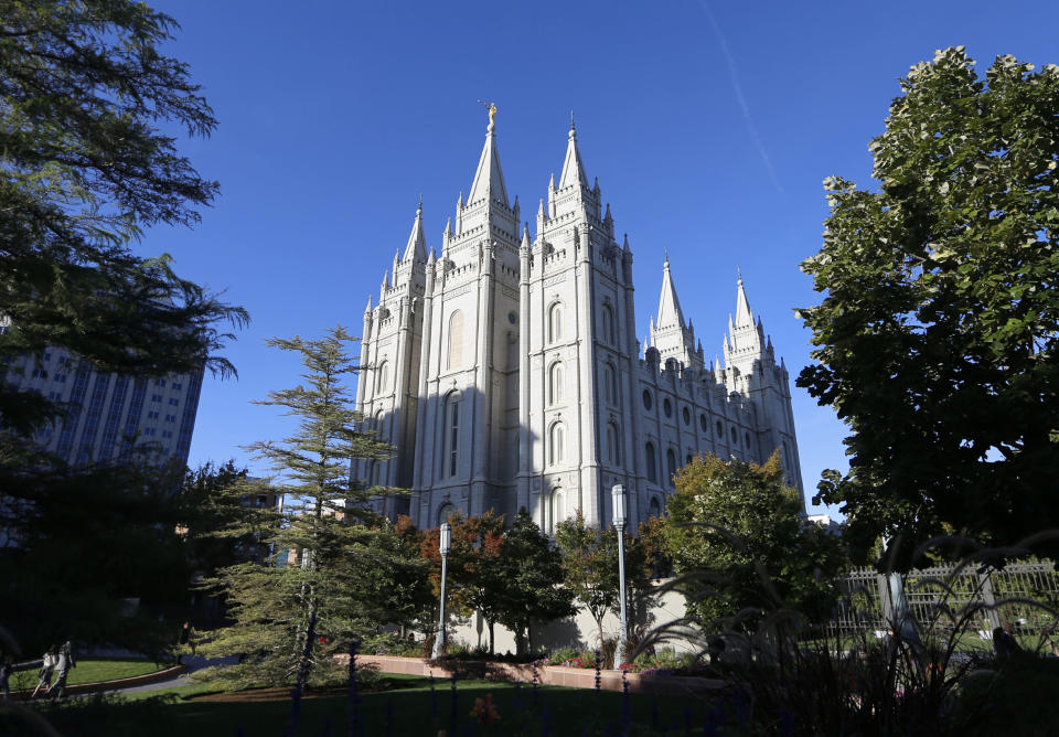 FILE - In this Oct. 5, 2019, file photo, The Salt Lake Temple stands at Temple Square in Salt Lake City. The Church of Jesus Christ of Latter-day Saints has announced that face masks will be required inside temples to limit the spread of COVID-19. Church leaders said Wednesday, Sept. 22, 2021, that masks will be required temporarily in an effort to keep temples open. (AP Photo/Rick Bowmer, File)