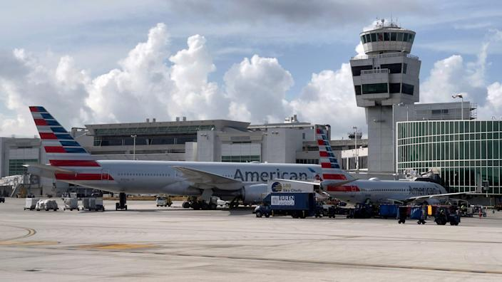 , Police said they have detained an American Airlines passenger who walked on the wing of a plane after it landed in Miami, The Evepost National News