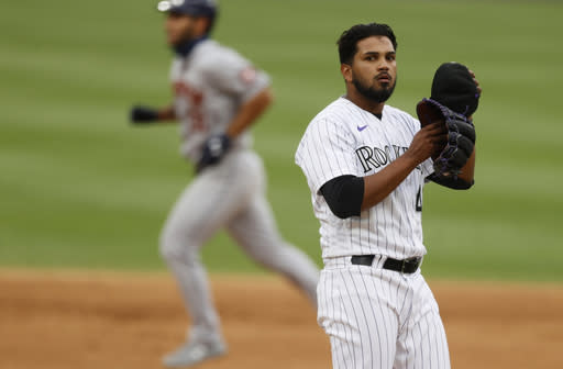 Colorado Rockies starting pitcher German Marquez, front, reacts as Houston Astros' Abraham Toro circles the bases after hitting a three-run home run off Marquez in the fifth inning of a baseball game Thursday, Aug. 20, 2020, in Denver. (AP Photo/David Zalubowski)