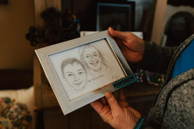 Caleb's parents, Kerri Countess and Storm Stenvold, created Forever14.org, a website dedicated to preventing youth suicide by promoting conversation and human connection. They have filed paperwork to create a nonprofit with the same mission. (Photo by Lauren Casto for KHN)