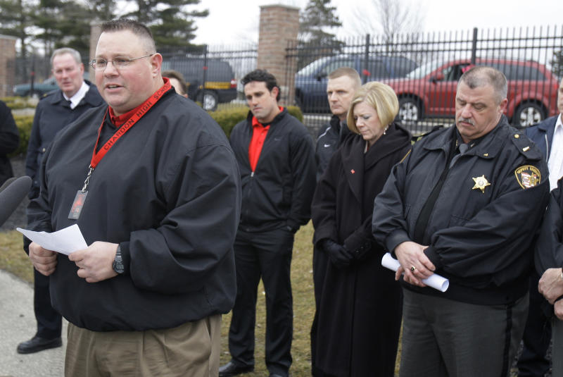 Assistant football coach Frank Hall talks to the media during a news-conference Thursday, March 1, 2012, in Chardon, Ohio. Three students were killed by a gunman Monday at Chardon High School. Hall chased the gunman out of the building. (AP Photo/Tony Dejak)