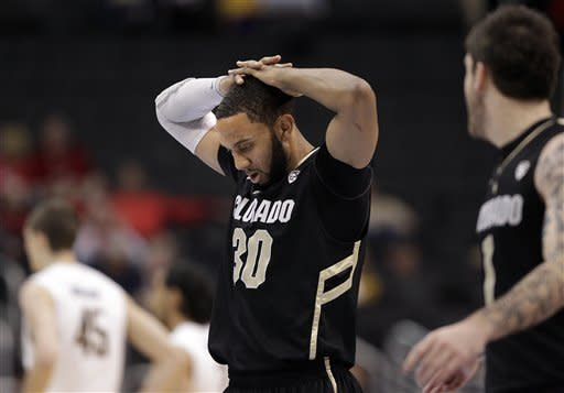 Colorado's Carlon Brown walks off the court during the first half of an NCAA college basketball game against California in the semifinals of the Pac-12 conference championship in Los Angeles, Friday, March 9, 2012. (AP Photo/Jae C. Hong)