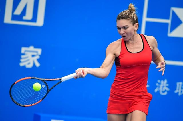 "Simona Halep, who currently has no clothing sponsor, confirmed she would wear the same ""lucky"" red dress in Australia that she used while winning at the Shenzhen Open (AFP Photo/-)"