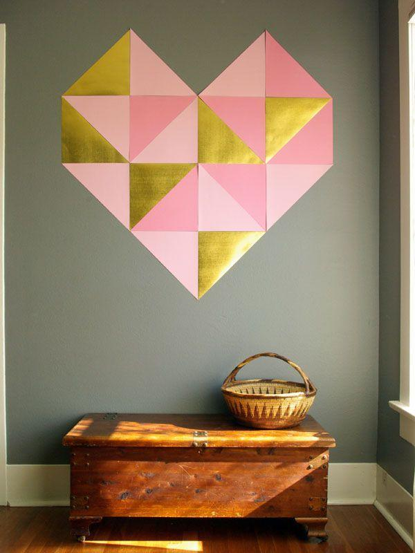 "<p>Take those construction paper hearts to the next level with this geometric heart DIY. The wall decor looks super hip, but still Valentine's Day appropriate, hung directly on a neutral wall. (If you're not ready to commit to something this big, you could always make a <a href=""http://www.oleanderandpalm.com/2013/01/framed-geometric-heart.html"" rel=""nofollow noopener"" target=""_blank"" data-ylk=""slk:mini framed version"" class=""link rapid-noclick-resp"">mini framed version</a> instead.)</p><p><em>Via <a href=""http://www.oleanderandpalm.com/2013/01/giant-geometric-wall-heart.html"" rel=""nofollow noopener"" target=""_blank"" data-ylk=""slk:Oleander + Palm"" class=""link rapid-noclick-resp"">Oleander + Palm</a> </em> </p><p><a class=""link rapid-noclick-resp"" href=""https://go.redirectingat.com?id=74968X1596630&url=https%3A%2F%2Fwww.potterybarnkids.com%2Fproducts%2Fabstract-heart-wall-art-minted%2F%3FcatalogId%3D10%26sku%3D2072614%26cm_ven%3DPLA%26cm_cat%3DGoogle%26cm_pla%3DDecor%2B%2526%2BLighting%2B%253E%2BWall%2BArt%26cm_ite%3D2072614%26gclid%3DCj0KCQiAsvTxBRDkARIsAH4W_j_0YDZjmriQ1qkdU1hWLmGHiHp9_FAyLNzLJYWr-EddpG2VzL3-YzEaAiieEALw_wcB&sref=https%3A%2F%2Fwww.elledecor.com%2Flife-culture%2Ffun-at-home%2Fg2387%2Fvalentines-day-decor%2F"" rel=""nofollow noopener"" target=""_blank"" data-ylk=""slk:GET THE LOOK"">GET THE LOOK</a><em><br>Abstract Heart Wall Art, Pottery Barn Kids, $71</em></p>"