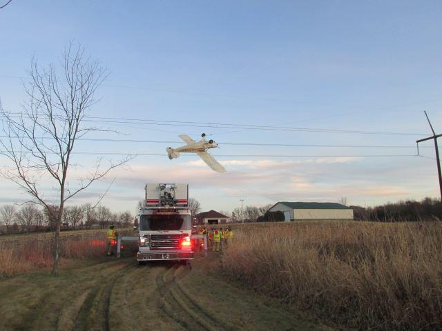 A single-engine Piper Cub propeller plane that became entangled with power lines in Louisville Township, Minnesota on Saturday. | Photo Courtesy of the Scott County Sheriff's Office