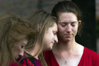 Summerleigh Winters Geimer, center, and her sister, Montana Winters Geimer, right, daughters of Wendi Winters, a community beat reporter who was killed in the Capital Gazette newsroom shooting, react during a news conference following the sentencing verdict of Jarrod W. Ramos, Tuesday, Sept. 28, 2021, in Annapolis, Md. Ramos was sentenced to more than five life terms without the possibility of parole, according to prosecutors. (AP Photo/Jose Luis Magana)
