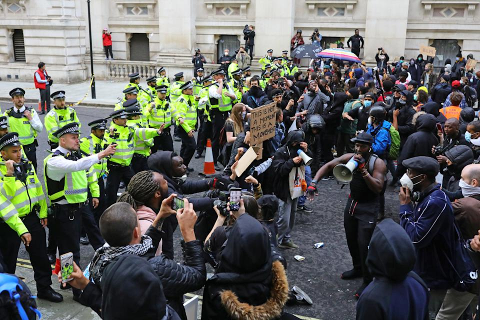 Police clash with protesters during a Black Lives Matter protest rally in Westminster, London, in memory of George Floyd who was killed on May 25 while in police custody in the US city of Minneapolis.