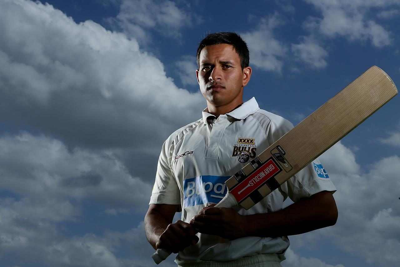 BRISBANE, AUSTRALIA - SEPTEMBER 25:  Usman Khawaja of the Queensland Bulls poses during a portrait shoot at Allan Border Field on September 25, 2012 in Brisbane, Australia.  (Photo by Chris Hyde/Getty Images)