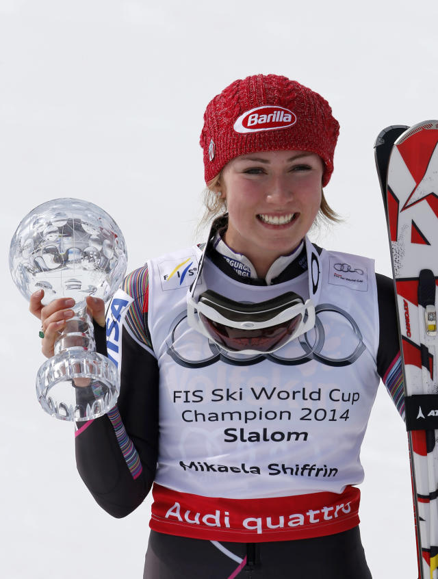 Mikaela Shiffrin, of the United States, poses for photographers with her trophy after winning an Alpine Ski women's slalom at the World Cup finals, in Lenzerheide, Switzerland, Saturday, March 13, 2013. (AP Photo/Marco Trovati)