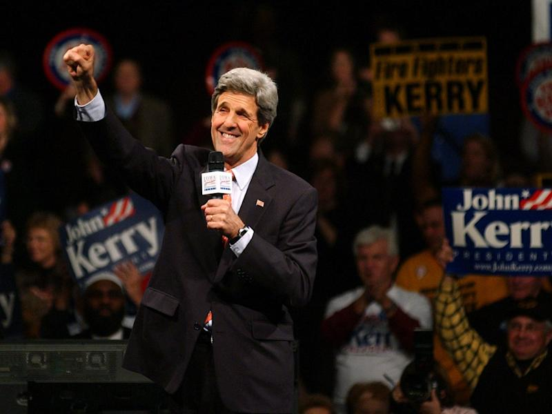 Democratic presidential hopeful Massachusetts Sen. John Kerry signals to supporters as he finishes speaking at the Iowa Democratic Party's annual Jefferson-Jackson Dinner, Saturday Nov. 15, 2003, in Des Moines, Iowa.