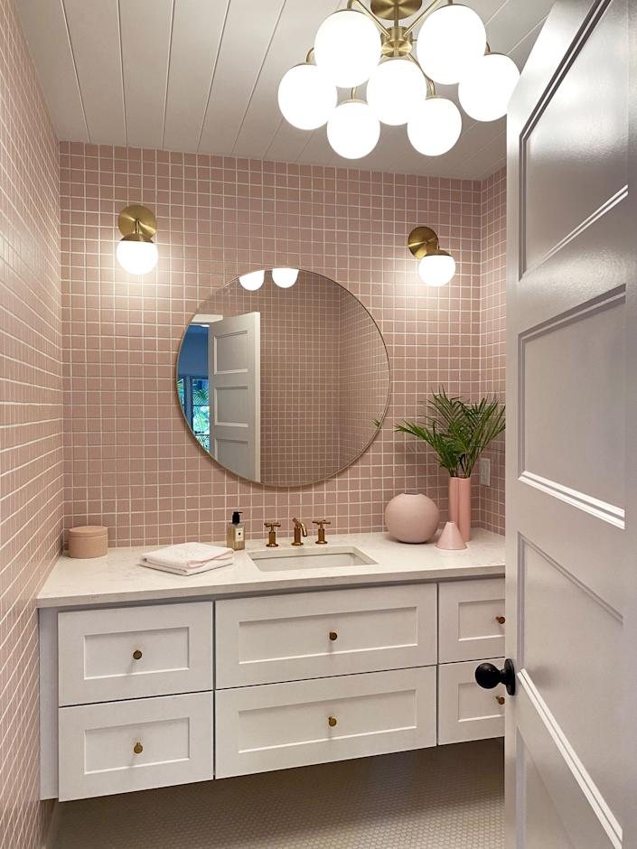 "<div class=""caption""> Not necessarily neutral are the 7,500 Brooklyn-sourced matte pink tiles that line all four walls of the guest bathroom. </div>"
