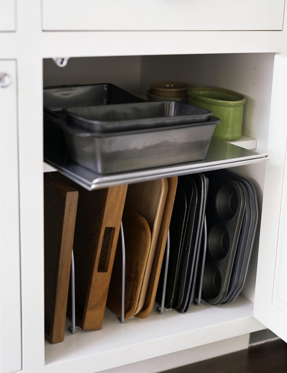 The baking tray cupboard of dreams. (Getty Images)