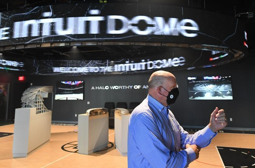 Clippers owner Steve Ballmer stands in front of a model of the Intuit Dome, the future Inglewood arena of the team.