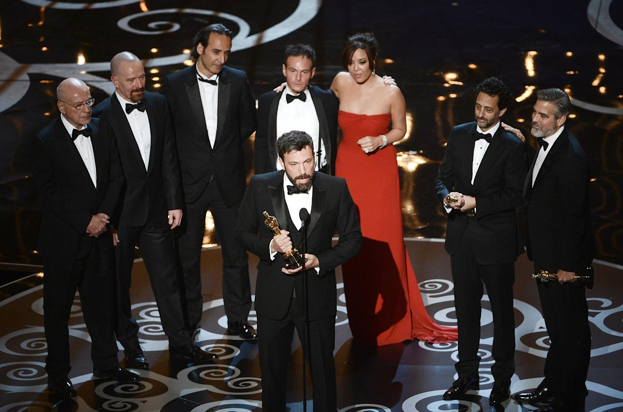 """HOLLYWOOD, CA - FEBRUARY 24:  Actor/producer/director Ben Affleck accepts the Best Picture award for """"Argo"""" onstage along with members of the cast and crew during the Oscars held at the Dolby Theatre on February 24, 2013 in Hollywood, California.  (Photo by Kevin Winter/Getty Images)"""