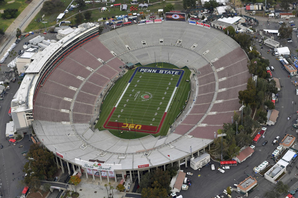 FILE - This Jan. 2, 2017, file pool photo, shows an aerial view of the empty Rose Bowl stadium before to the Rose Bowl NCAA college football game between Southern California and Penn State in Pasadena, Calif. The Rose Bowl was denied a special exemption from the state of California to allow a few hundred fans to attend the College Football Playoff semifinal on Jan. 1, putting the game staying in Pasadena in serious doubt. A person involved with organizing the game told The Associated Press the Tournament of Roses' request was denied earlier this week. (The Tournament of Roses via AP, Pool, File)