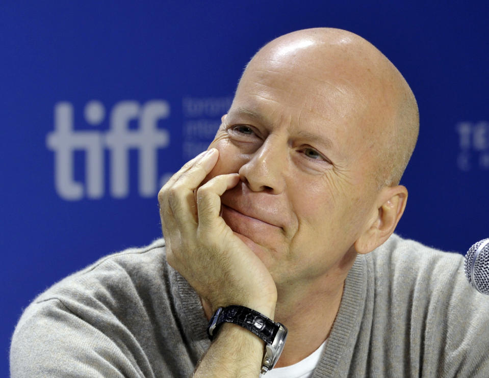 """Actor Bruce Willis listens during the news conference for the film """"Looper"""" at the 37th Toronto International Film Festival September 6, 2012. REUTERS/Mike Cassese (CANADA - Tags: ENTERTAINMENT)"""