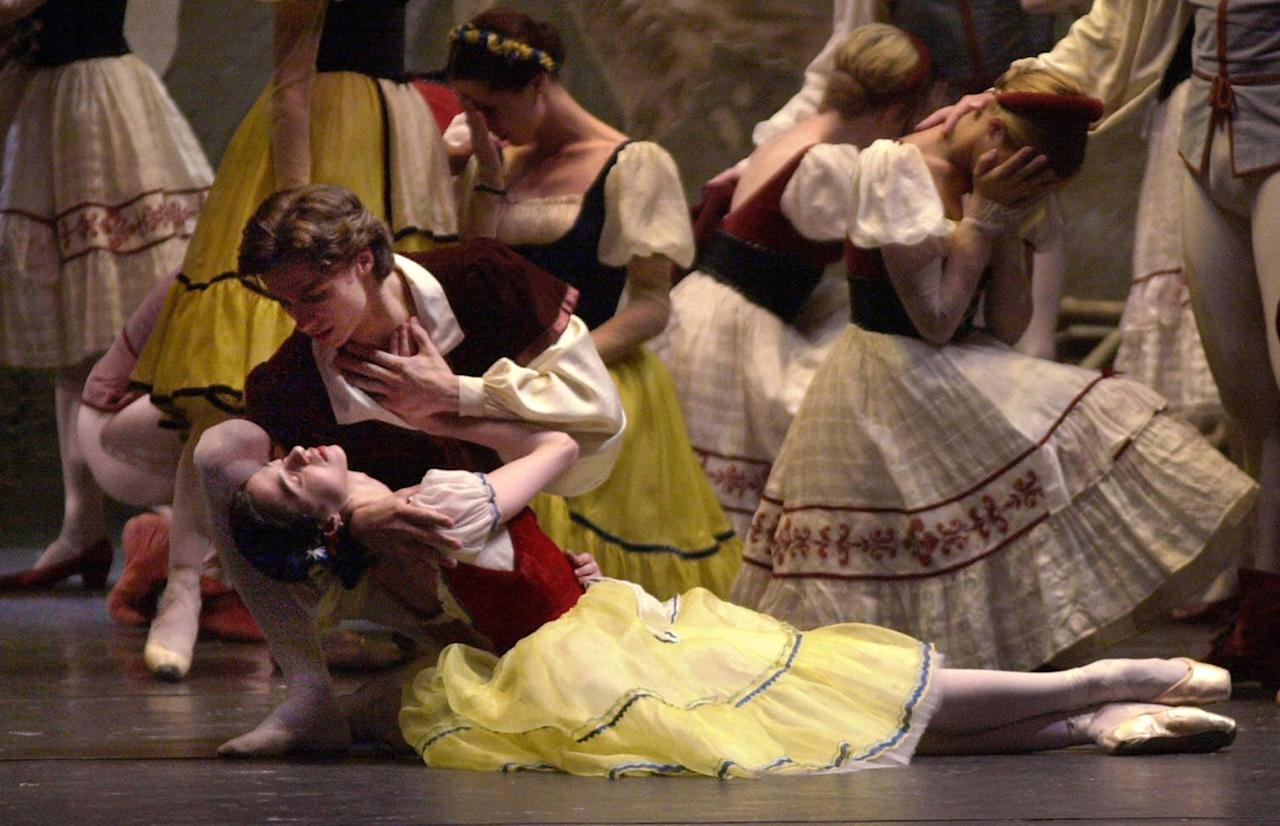 "FILE - In this Tuesday, July 18, 2000 file photo, Sergei Filin as Albrecht and Nina Ananiashvili as Giselle perform a tragic scene during a dress rehearsal of the Bolshoi Ballet's United States premiere of ""Giselle"" at The Lincoln Center for the Performing Arts, in New York. Filin was attacked in Moscow on Thursday night, Jan. 17, 2013, by an unknown person who splashed acid onto his face. (AP Photo/Kathy Willens, File)"