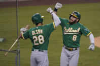 Oakland Athletics' Robbie Grossman, right, celebrates his solo home run with Matt Olson during the first inning of a baseball game against the Los Angeles Dodgers Tuesday, Sept. 22, 2020, in Los Angeles. (AP Photo/Ashley Landis)