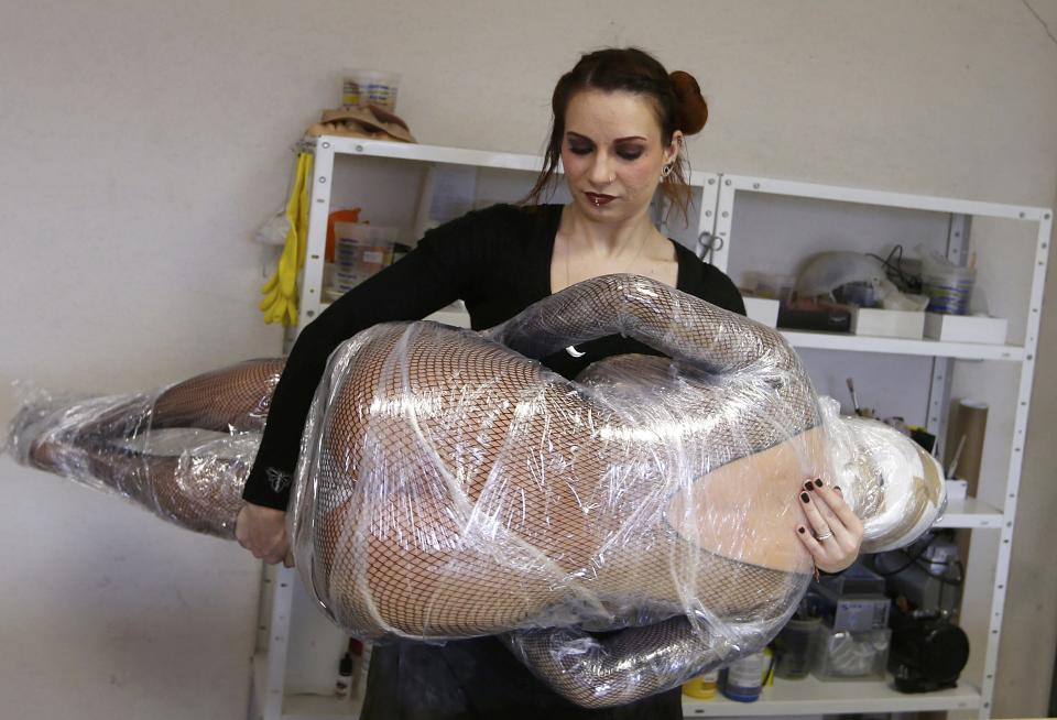 Raphaela, an employee at the Dreamdoll company, prepares a silicone dream doll for shipment in their workshop in Duppigheim near Strasbourg, February 18, 2015. The realistic silicone dolls can be ordered from a catalogue based on four hair and eye color models for a base price of 5,500 euros ($6,150). The dolls weigh around 40 kilos due to a lightweight aluminum structure and take a week to construct. The company of three employees produces some one hundred custom-made silicone sex dolls a year, mainly for European customers. Picture taken February 18, 2015. REUTERS/Vincent Kessler (FRANCE - Tags: SOCIETY BUSINESS)