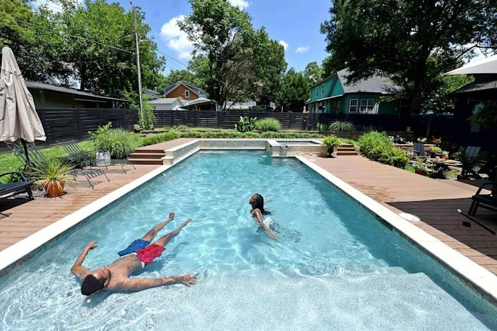 Shane Richards and Samantha Flanigan enjoy an afternoon swim at a Charlotte, NC home on Wednesday, July 14, 2021. The owner placed his pool on the app Swimply last month. The app gives pool owners the ability to charge people to use their pool by the hour.